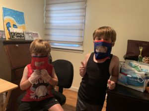 two kids modeling masks