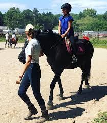 boy recievng horseback riding lesson at silver rock farm
