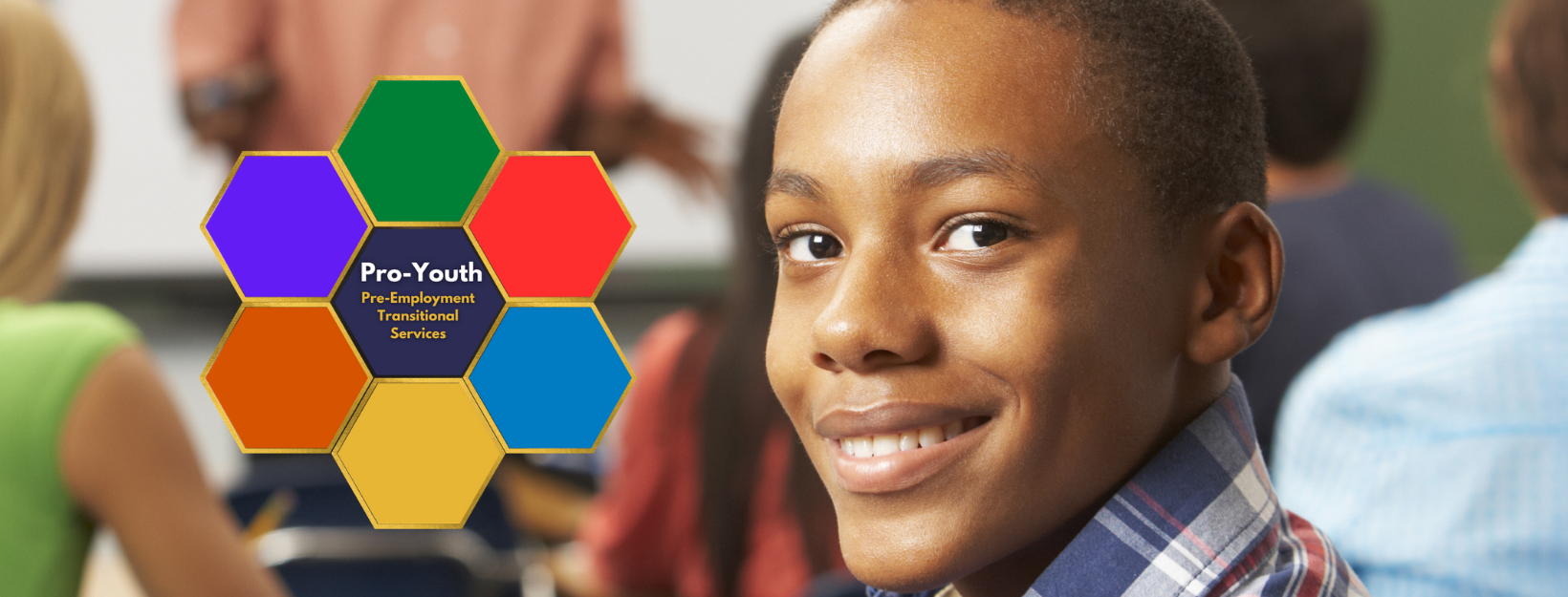 boy smiling in classroom with pro youth logo on side