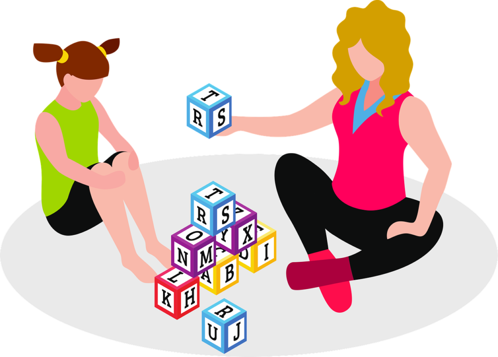 graphic of two girls playing with letter blocks